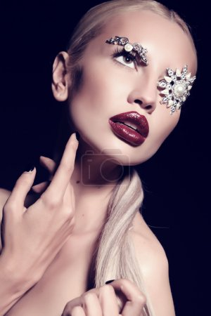 Photo for Fashion studio portrait of beautiful sexy woman with blond hair with fantastic makeup with bijou accessories - Royalty Free Image