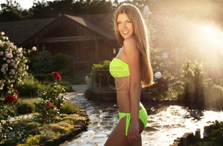 beautiful girl with long straight hair wearing elegant bikini