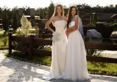 beautiful girls wearing elegant dresses and luxurious crown