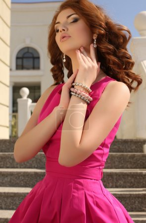 Photo for Fashion outdoor photo of beautiful young woman with dark hair in elegant pink dress - Royalty Free Image