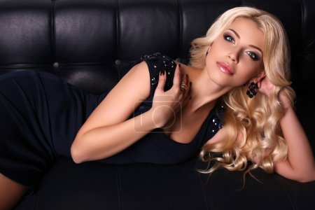 Photo for Fashion studio photo of beautiful charming woman with long blond hair wears elegant dress and accessories - Royalty Free Image