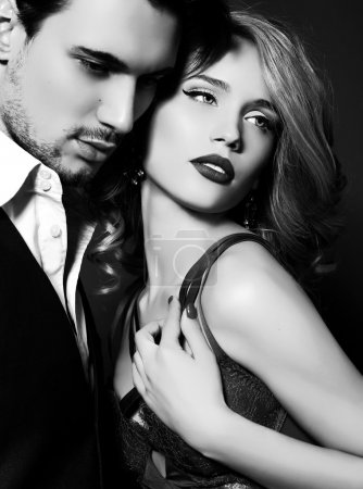 studio photo of beautiful couple, wears elegant clothes,