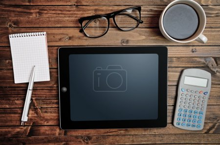 Photo for Tablet empty screen with calculator on desk - Royalty Free Image