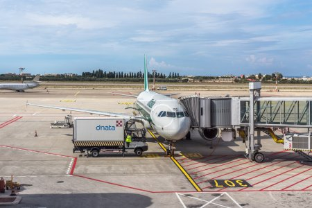 ALITALIA airplane parked at terminal. loading and maintenance operations before to flight