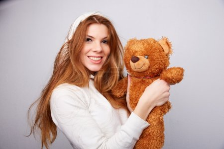 Red-haired woman with teddy bear