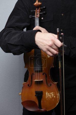 Man with vintage violin