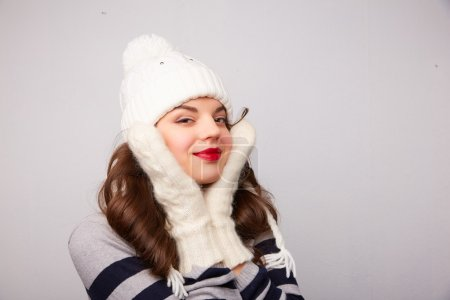 Girl in white hat and scarf