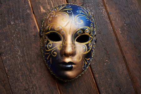 Venetian mask on a wooden table