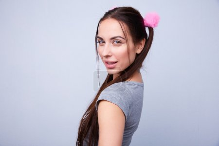 Young beautiful girl with pigtails