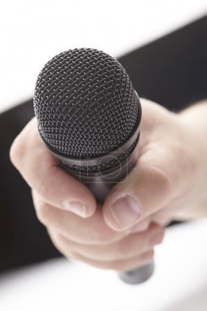 Wireless microphone in man's hand
