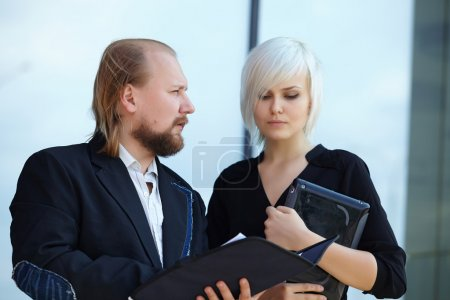 businessman and business woman discussing