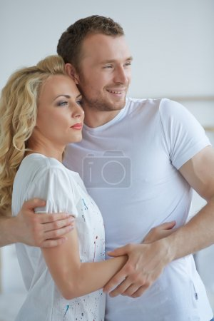couple standing embracing