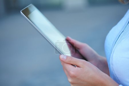 Photo for Girl holding tablet close-up - Royalty Free Image