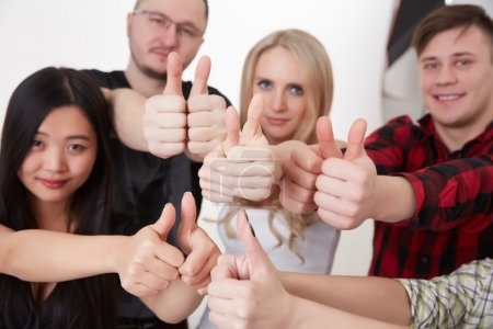Students showing thumbs up