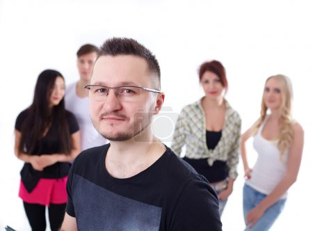 man in glasses over students