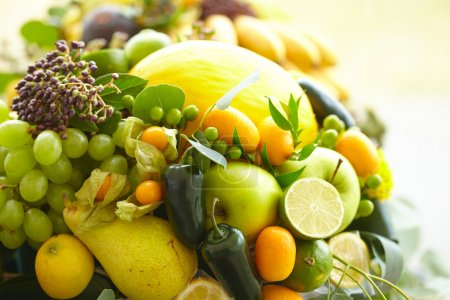 Photo for Fruit basket closeup bananas, apples, grapes, apricots, melon, lime - Royalty Free Image