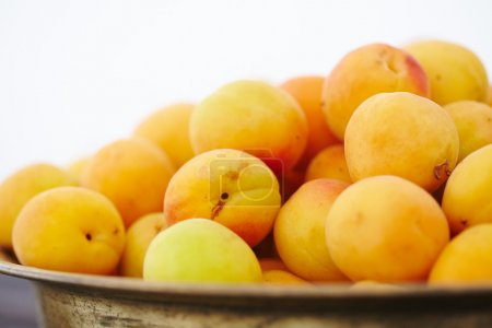 dish with fresh apricots