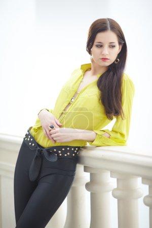 beautiful woman in yellow blouse