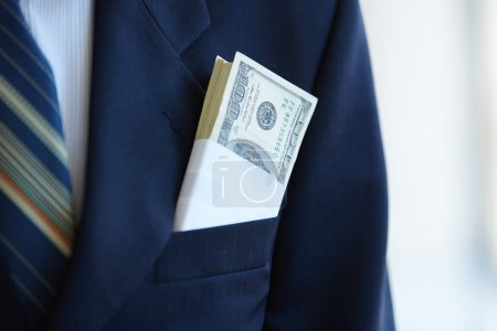 Photo for Sticking out of money from businessman pocket - Royalty Free Image