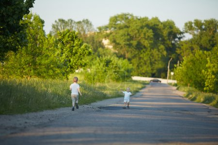 Little boys on rural road
