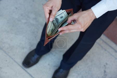 male with wallet with money