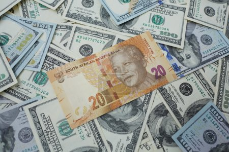 Twenty rand against the background of dollars