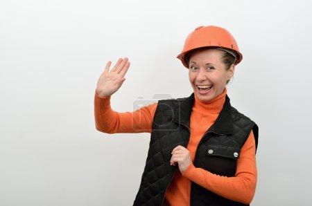 Photo pour Générateur de femme vous accueille, tenant la main et souriant - image libre de droit
