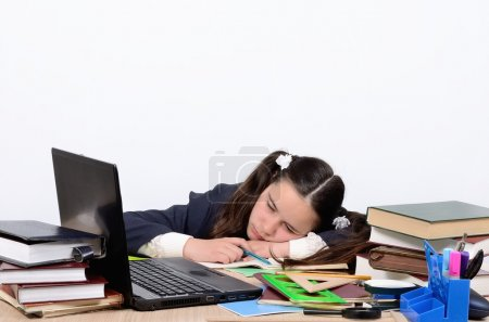 Schoolgirl teen tired of training and slept with his head on school desk near the computer