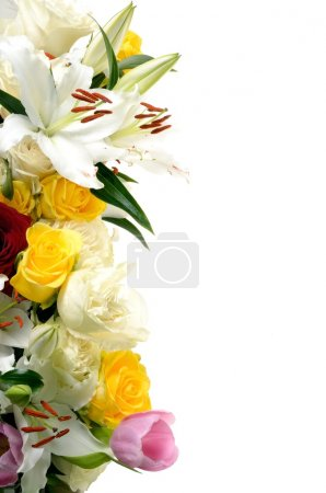 Composition is Multicolored flowers different grades - lilies, roses, tulips and blank space for your text on a white background