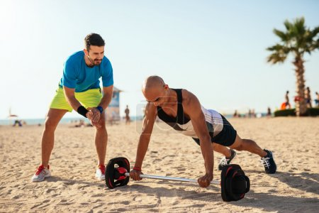 Doing fitness on the beach