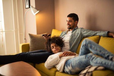 Watching television at home