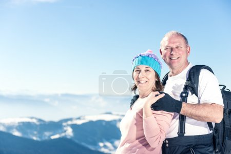 Happy middle aged couple on the top