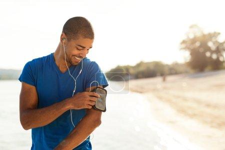 Choosing his favorite workout music