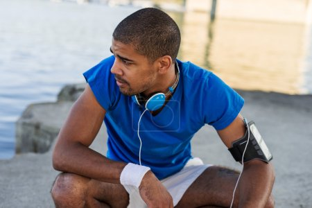 Photo for Young male athlete taking a break from running. - Royalty Free Image