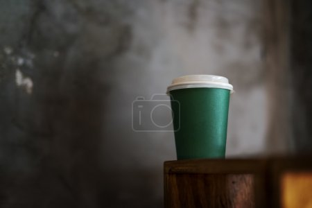 Photo for Green coffee to go cup with no branding. Shallow dept of field - Royalty Free Image
