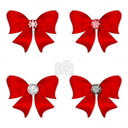 Set of four red bows for decoration.