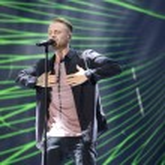 Постер, плакат: Russian pop singer Egor Kreed performs during the 25th Slavyansky Bazar Festival