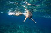 Young Women Snorkeling in the Tropical Water