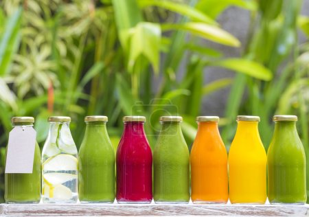 Photo for Organic cold-pressed raw vegetable juices in glass bottles - Royalty Free Image