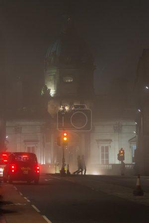 Bank of Scotland building in a foggy night in Edinburgh, Scotlan