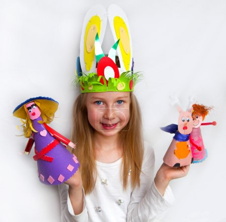 Little girl demonstrating her cruft works, Easter bonnets