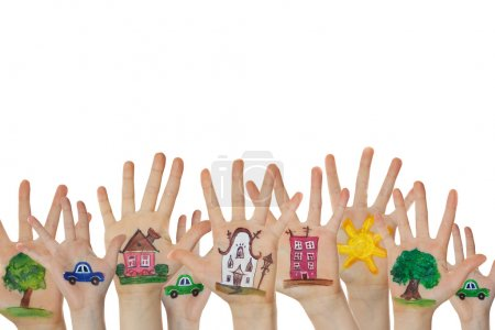 Photo for Abstract street made of painted symbols. Houses, trees, cars painted on children hands raised up. - Royalty Free Image