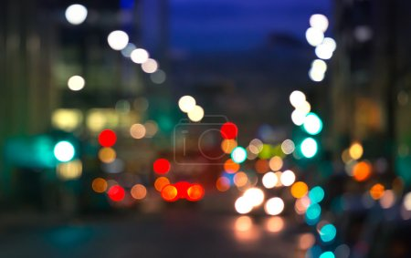 City lights blur background. London, Canary Wharf night life. Traffic, roads, lanterns and lit up office buildings