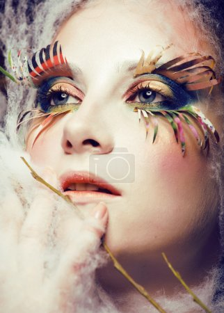 woman with creative make up close up