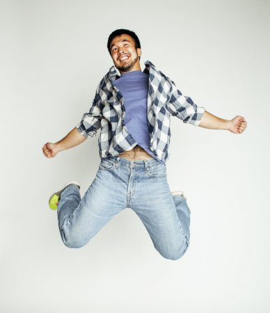 young pretty asian man jumping
