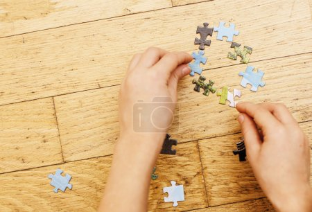 little kid playing with puzzles