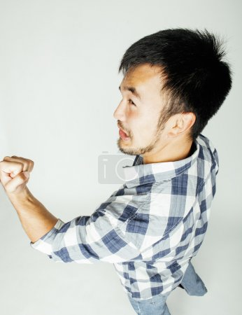 young cute asian man on white background gesturing emotional, pointing, smiling, lifestyle people concept