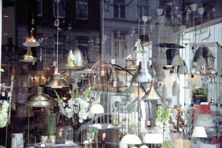 electric- light store. chandelier interior window