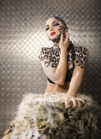 Photo for Young sexy woman with leopard make up all over body, cat bodyart print closeup sensual - Royalty Free Image