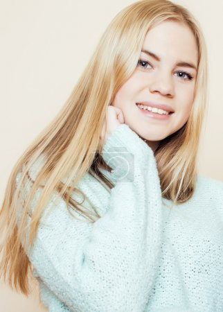 young pretty blond teenage girl close up portrait, lifestyle people concept